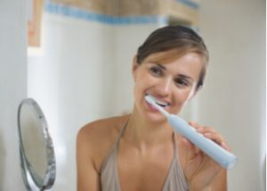 importance proper way to brush teeth with electric toothbrush
